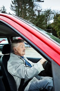 Elderly man in car